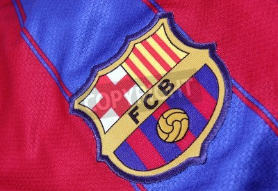 Póster Barcelona, Spain - January 28, 2012: The crest of Barcelona Football Club on an official jersey. FC Barcelona were founded in 1899.