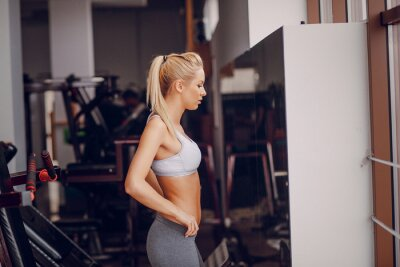 Póster Beautiful blonde doing gym exercises