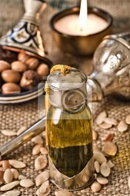 Bodegón de aceite de argán con frutas