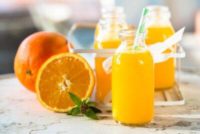Póster Botella de jugo de naranja