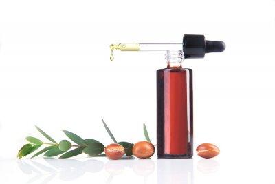 Bottle of argan oil on white