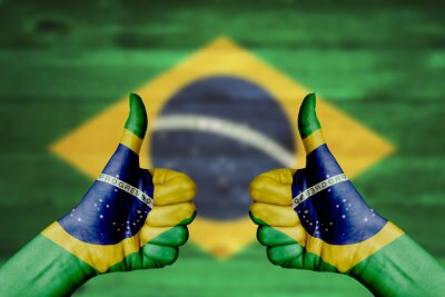 Póster Brazil flag painted on female hands thumbs up