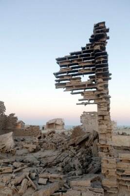Broken wall of bricks in a Namibian Ghost Town.