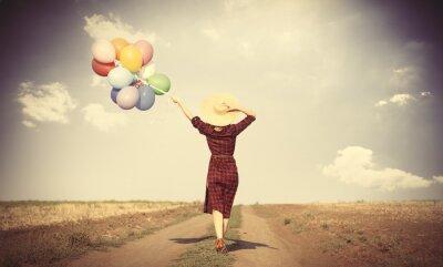 Póster chica con globos multicolores y bolso
