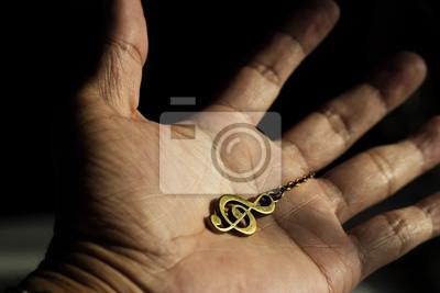Clef de la música en la mano