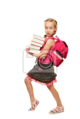 Colegiala litthe feliz con una pila de libros pesados