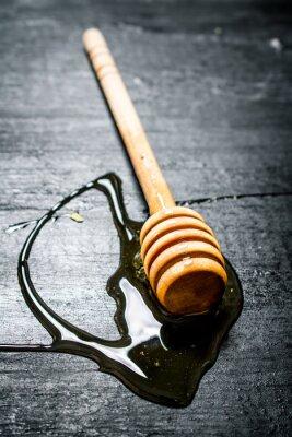 Póster Cuchara de madera de miel dulce natural.