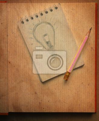 dibujo de la bombilla de luz sobre el papel de nota