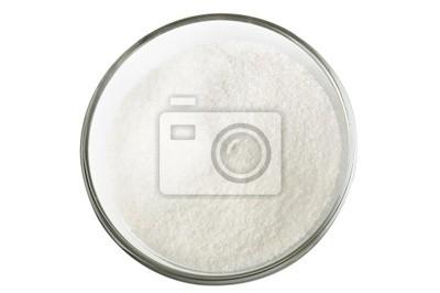El azúcar en un tazón de vidrio