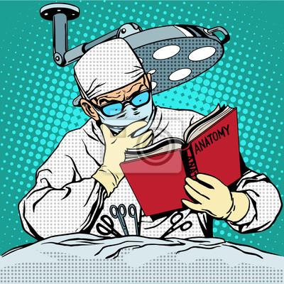 El cirujano antes de la cirugía está leyendo anatomía. Medicina y cura