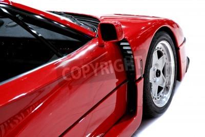 Póster El extremo lateral y frontal de un coche deportivo de color rojo