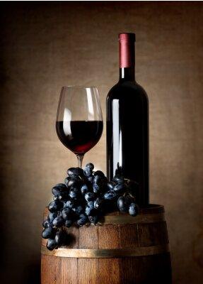 Póster El vino rojo con el barril y uvas