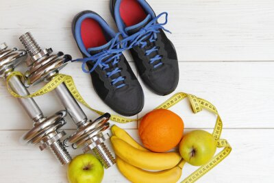 Póster fitness equipment and healthy nutrition on white wooden plank fl