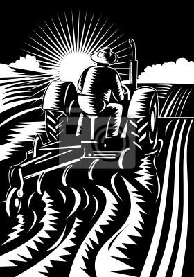 Granjero en el campo tractor arando