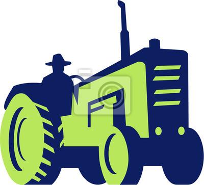 Granjero orgánico que conduce el tractor de la ma