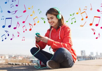 Póster happy young woman with smartphone and headphones