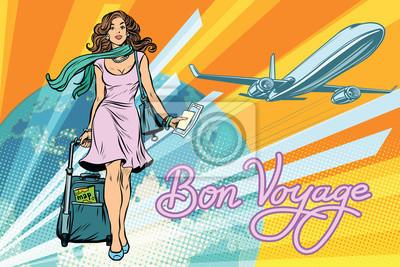 Hermosa chica con un billete para el vuelo