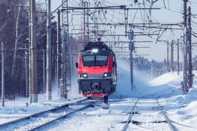 High speed train approaches to the station at winter day time.