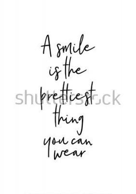 Póster Letras dibujadas a mano. Ilustración de tinta Pincel de caligrafía moderna. Aislado en el fondo blanco Una sonrisa es la cosa más bonita que puedes usar.