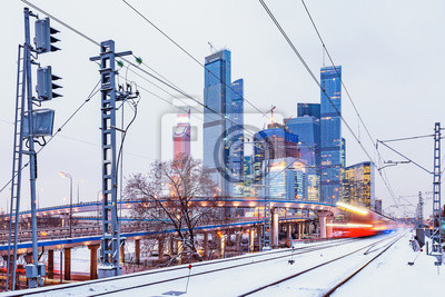 Modern high-speed train arrives to the station at winter evening time. Moscow. Russia.