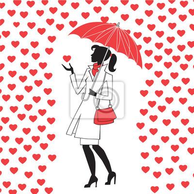Mujer con paraguas bajo la lluvia de corazones rojos