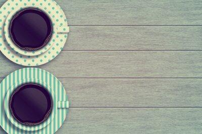 Póster Par de tazas de café en la mesa de madera