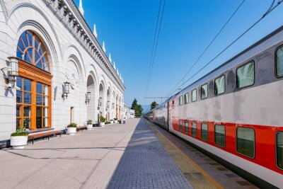 Passenger double deck train is ready to depart from the main railway station. Sochi. Russia.