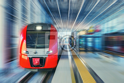 Passenger high speed train moves fast along the railway station platform.