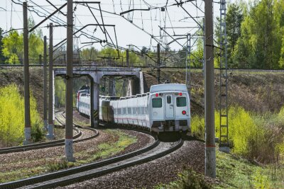 Passenger train moves through the tunnel at spring day time.
