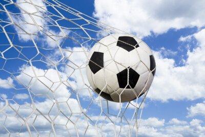 Póster Pelota de fútbol en red de gol