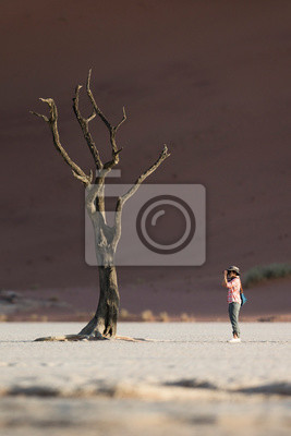 Photographer photographing trees