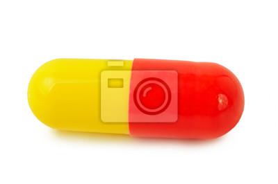 Píldoras médicas rojo-amarillas individuales
