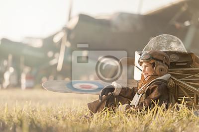 Retrato de un aviador joven estacionado aviones