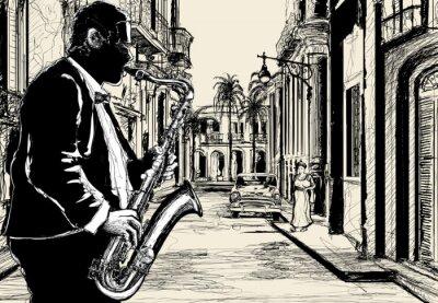 Póster saxofonista en una calle de Cuba