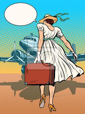 Señora avión de pasajeros con equipaje