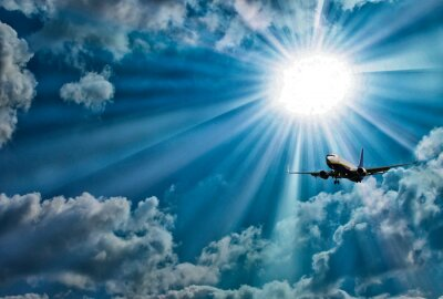 Silhouette of airplane with a beautiful sky