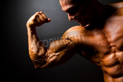 Póster strong bodybuilder posing on black background