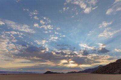Sun rays through clouds in the morning Namib Desert