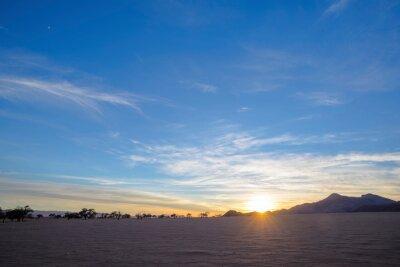 Sunrise at dry barren desert