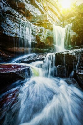 Póster Tropical waterfall with sun rays