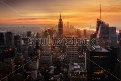 Póster View of New York City from the top of one of its viewpoints, capturing the warm light of sunset