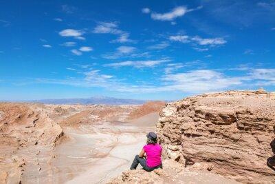 Woman tourist hiking in Atacama desert savanna, mountains and volcano landscape, Chile, South America