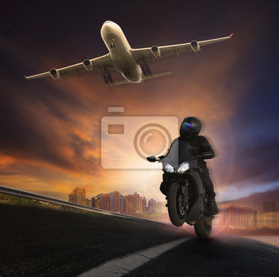 young man riding motorcycle on asphalt highways road with high s