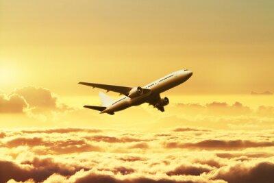Vinilo Aeroplano en el cielo al atardecer