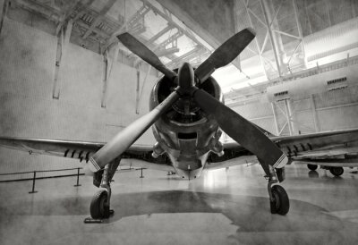 Vinilo Antiguo avión en un hangar
