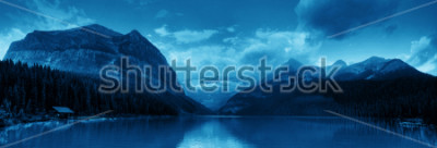 Vinilo Banff national park Lake Louise sunrise panorama with mountains and forest in Canada.