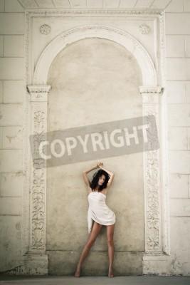 Vinilo Beautiful sexy woman posing in a castle interior