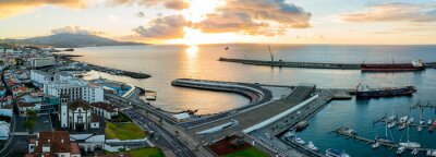 Vinilo City harbor view at Ponta Delgada, capital city of the Azores at Sao Miguel Island during epic sunset time. November 10, 2017. Azores, Portugal.