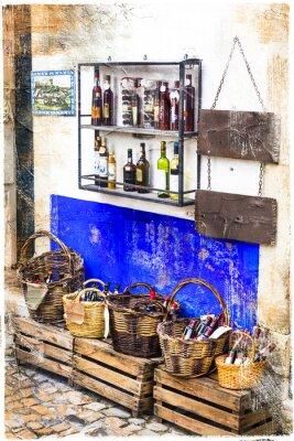 Vinilo Coloridas tiendas del casco antiguo de la ciudad de Obidos en Portugal, cuadro artístico