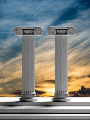 Vinilo Dos pilares antiguos con el fondo del cielo de la puesta del sol.